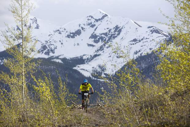 A mountain biker pedals on the Frisco Peninsula Recreation Area trails during Thursday's first Summit Mountain Challenge mountain bike event of the season, the Frisco Roundup, Peak 1 in view in the distance.