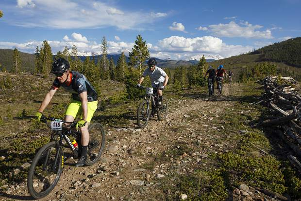 Nathan De Graaf of Breckenridge leads a pack of mountain bikers on the Frisco Peninsula Recreation Area trails during Thursday's first Summit Mountain Challenge mountain bike event of the season, the Frisco Roundup.