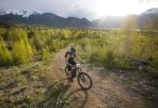 Justyn Barton of Dillon pedals on the Frisco Pensinsula Recreation Area trails during Thursday's first Summit Mountain Challenge mountain bike event of the season, the Frisco Roundup, the TenMile Range and Buffalo Mountain in view in the distance.