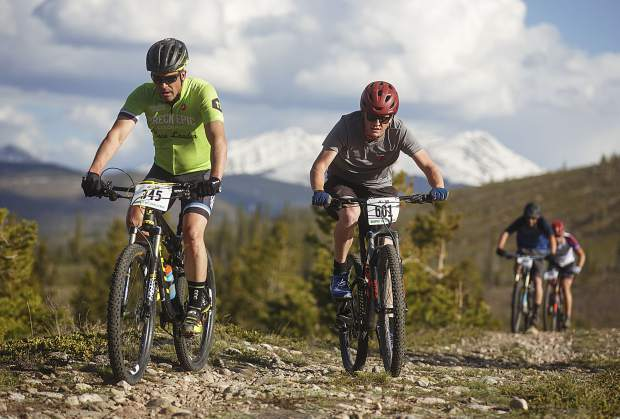 Craig Campbell of Breckenridge and William Besson of Evanston, Illinois pedal on the Frisco Peninsula Recreation Area trails during Thursday's first Summit Mountain Challenge mountain bike series event of the season, the Frisco Roundup, the peaks of Baldy and Guyot in view in the distance.