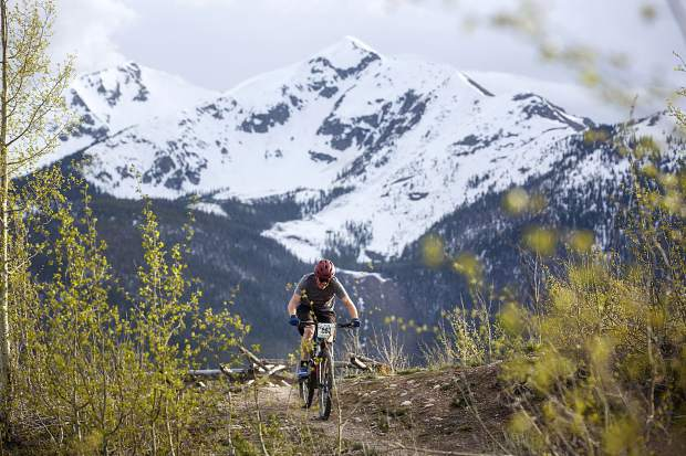 A mountain biker pedals on the Frisco Peninsula Recreation Area trails during Thursday's first Summit Mountain Challenge mountain bike event of the season, the Frisco Roundup, Peak One in view in the distance.