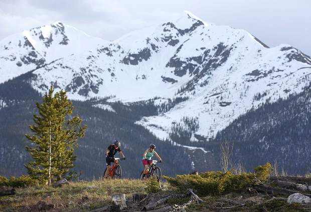 Mountain bikers pedal on the Frisco Peninsula Recreation Area trails during Thursday's first Summit Mountain Challenge mountain bike event of the season, the Frisco Roundup, Peak 1 in view in the distance.