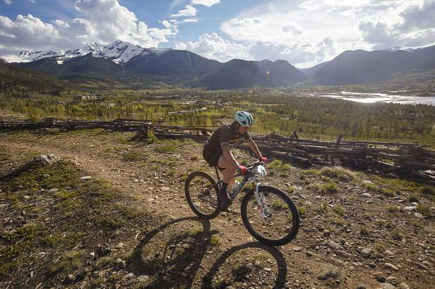 A mountain biker pedals on the Frisco Peninsula Recreation Area trails during Thursday's first Summit Mountain Challenge mountain bike event of the season, the Frisco Roundup, the Tenmile Range in view in the distance.