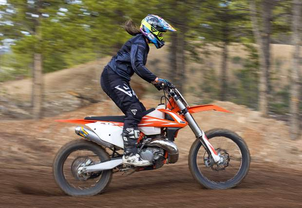 A girls-night rider rides her dirt bike during the weekly