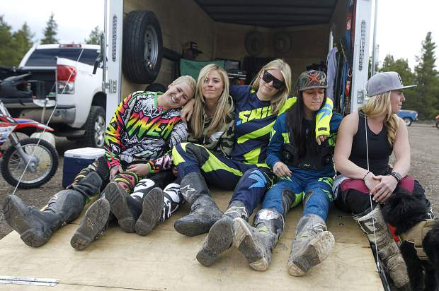 Girls-night riders (from left to right) Ali Gee, Ali Leonard, Kristen Kohl, Jaime Schulte and Shannatay Bergeron hang out while gearing up before the weekly