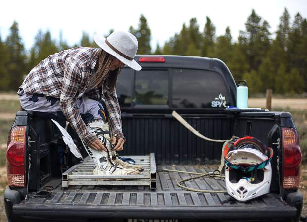 Amy Kwak of Silverthorne gears up in her truck bed before the weekly