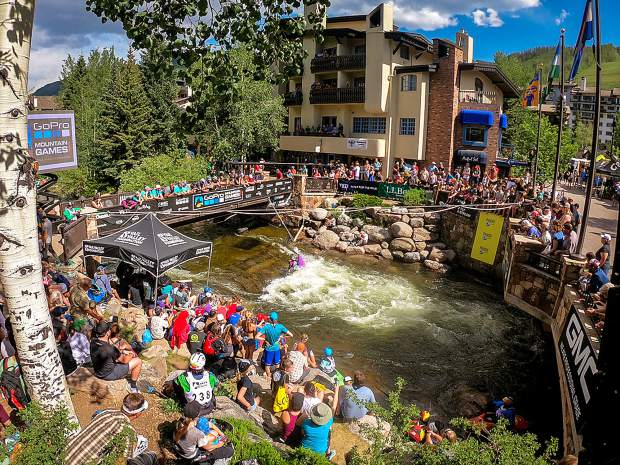 "The kayak hole at the center of L.L.Bean Gear Town is often referred to as the ""I-bridge"" or ""International Bridge"" where spectators gather to watch the best kayakers in the world. This is the heart of the GoPro Mountain Games action during the GMC Freestyle Kayak competition."