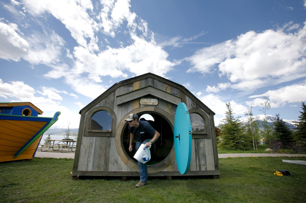 Marcus Sandberg, of Campbell Construction, makes final touches on a playhouse Thursday, June 27, in Dillon.