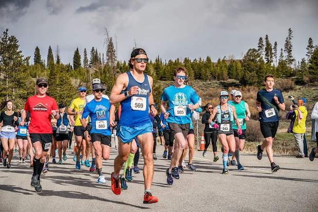 The winner of Saturday's Run The Rockies half-marathon race, Franklin Reilly of Edwards (Bib 569) runs during the annual race in Frisco, third-place finisher Paul Steinweg of Breckenridge (Bib 593) behind him at left.