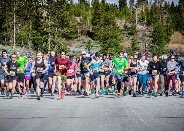 Runners embark from the start line of Saturday morning's Run The Rockies 10K race in Frisco, including top-5 local Summit County finishers Dominyk Remeikis (Bib 119), Zach McBride (Bib 170) and Paul Hans (Bib 172).