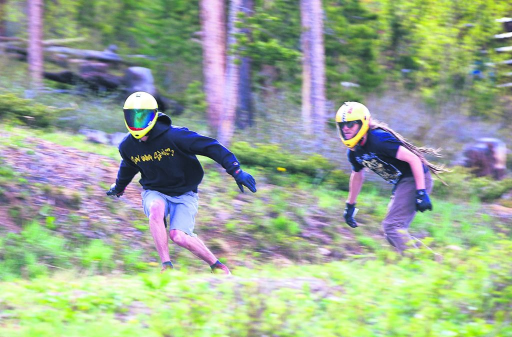 Russell Janoviak, left, and Kyle Peel ride downhill on skateboards on Friday June 21, in Breckenridge.