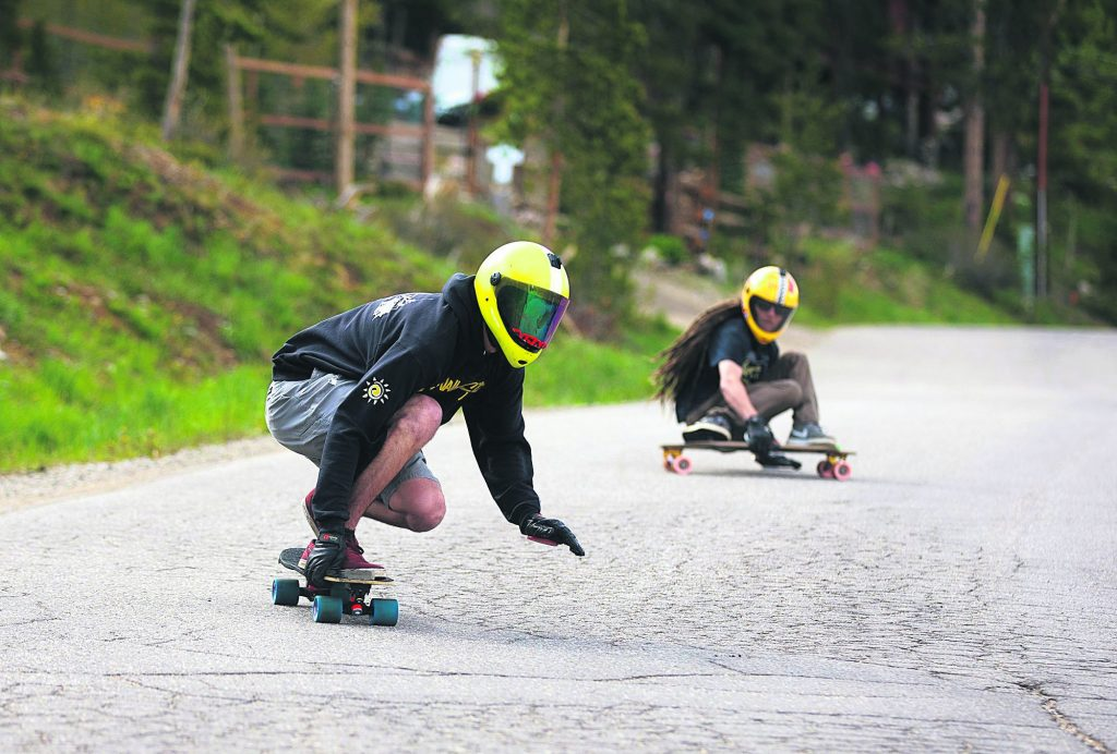 Ohio native and Breckenridge resident Russell Janoviak races down on a skateboard on Friday June 21, in Breckenridge.