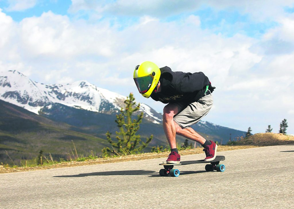 Russell Janoviak tucks to gain speed on his skateboard while downhilling on Friday June 21, in Breckenridge.