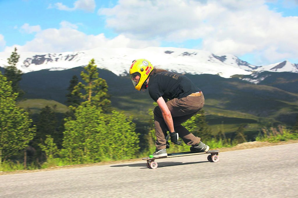 Kyle Peel tucks to pick up speed while riding his downhill skateboard on Friday June 21, in Breckenridge.