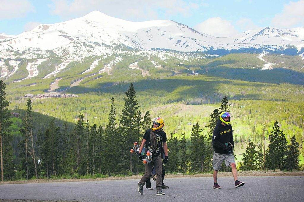 Russell Janoviak, right, and Kyle Peel walk back up the road on Friday June 21, in Breckenridge, Breckenridge Ski Resort in view in the distance.