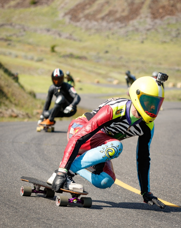 These kinds of full-body leather suits are the gear downhill skateboarders like Russell Janoviak (front) wear during officially-sanctioned racing events.
