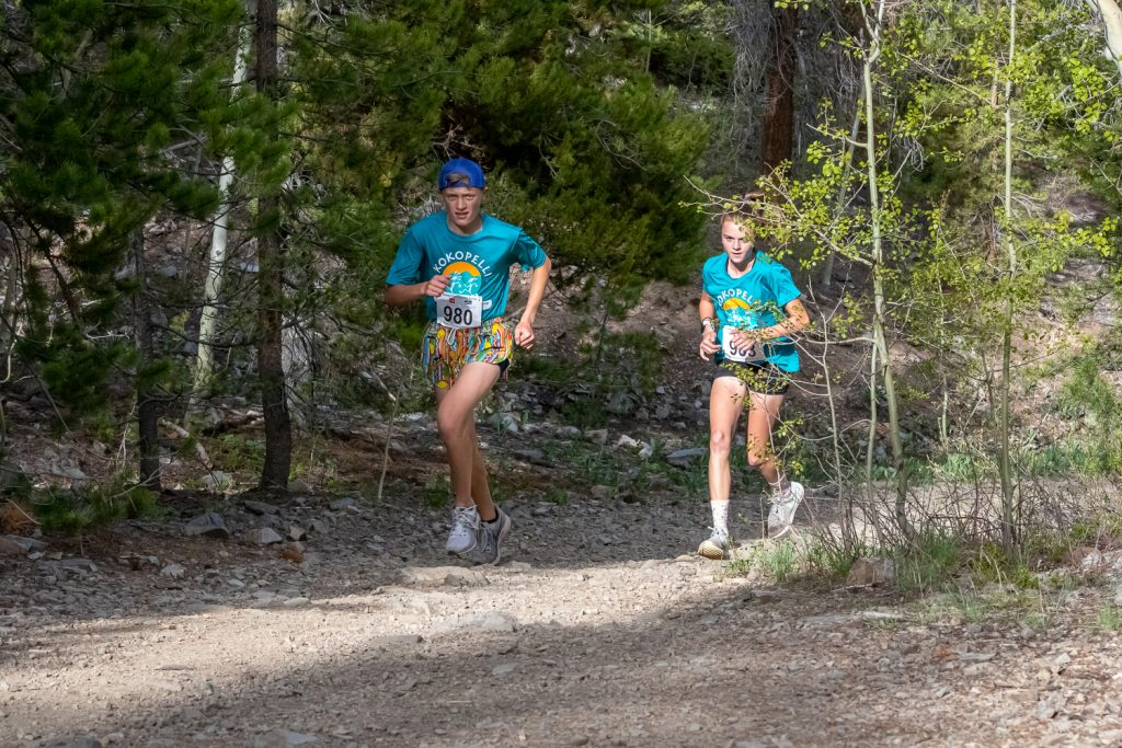 5K short course winner and 13-year-old Nate Lumaye, left, leads a pack of runners during Wednesday's second Summit Mountain Challenge event of the season, the French Gulch 5K/8K in Breckenridge.