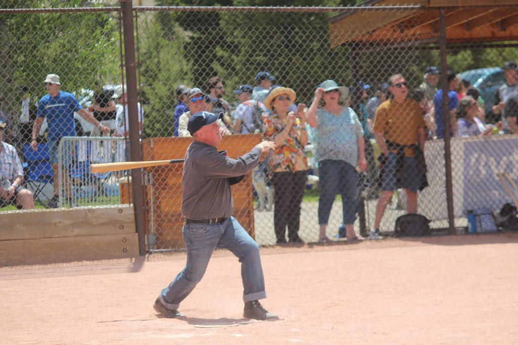 The home cranks cheer as a ballist for the Summit Sluggers hits a corker into the outer garden during the Sluggers' 19-12 victory over the visiting Star Base Ball Club of the Colorado Territory on Saturday at the Frisco Adventure Park.