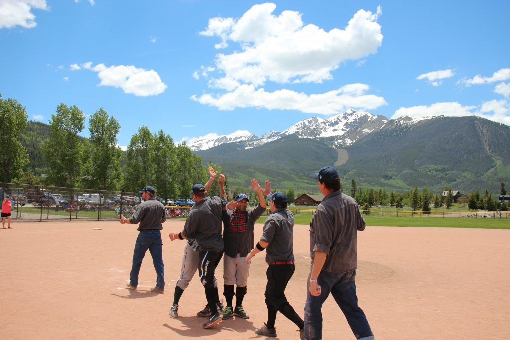 The Summit Sluggers rejoice in the inner garden at Frisco Adventure Park after defeating the visiting Star Base Ball Club of the Colorado Territory 19-12, the snow-capped TenMile Range in view in the distance.