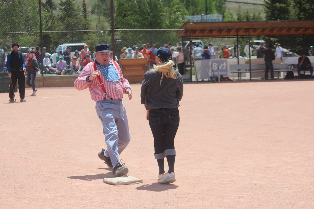 A base runner for the Star Base Ball Club of the Colorado Territory steps onto the second bag while Summit Slugger Liz