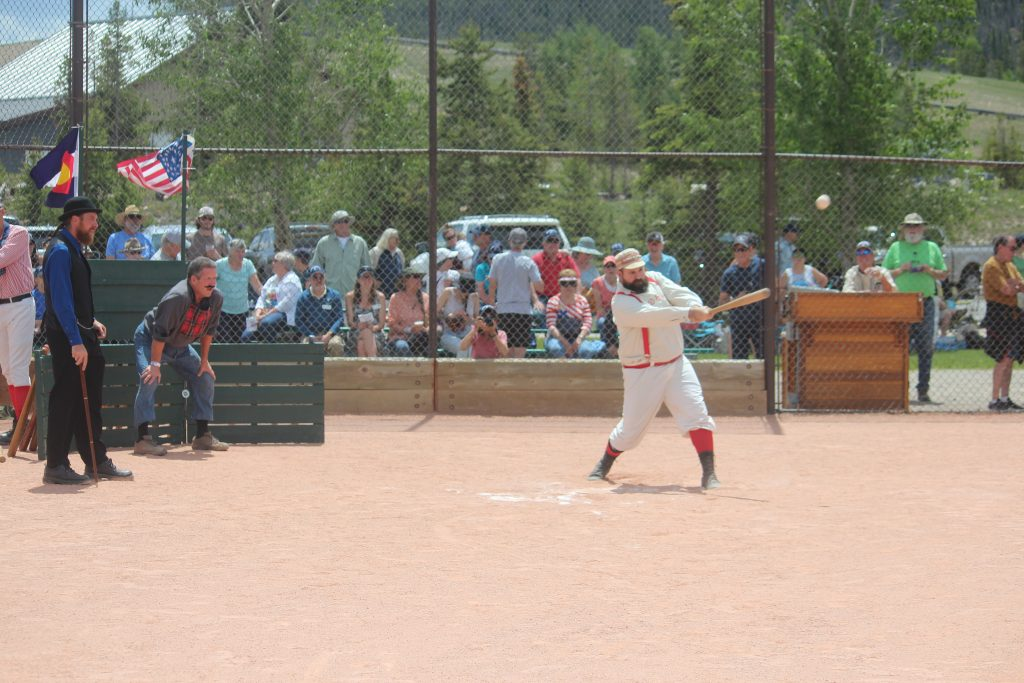 A ballist for the Star Base Ball of the Colorado Territory strikes a bounder during Saturday's first-ever Summit Historical Society Vintage Base Ball Game at the Frisco Adventure Park.