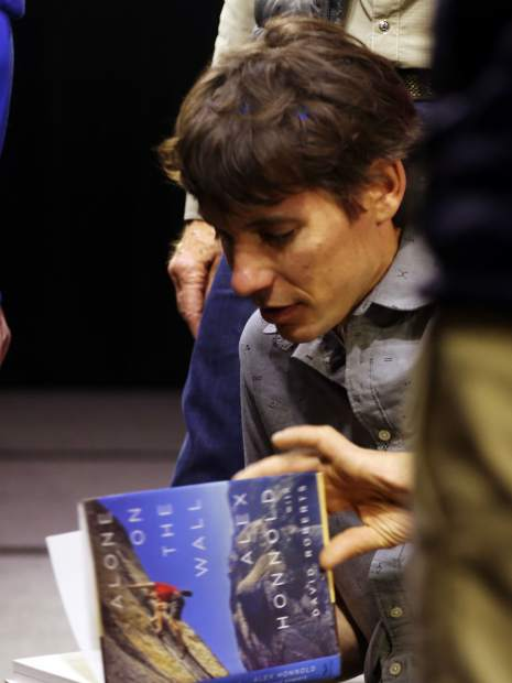Climber Alex Honnold signs autographs after talking during an Aspen Ideas Festival discussion on Monday inside the St. Regis hotel in Aspen.