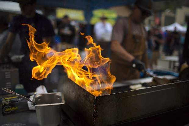 Flames flare from a grill Saturday June 15, during the 26th Annual Colorado BBQ Challenge on Main Street in Frisco.