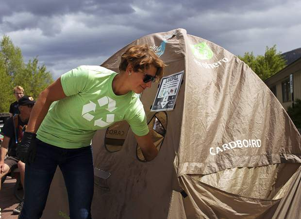 Eva Havlova works a zero waste disposal tent June 15 during the 26th annual Colorado BBQ Challenge on Main Street in Frisco.