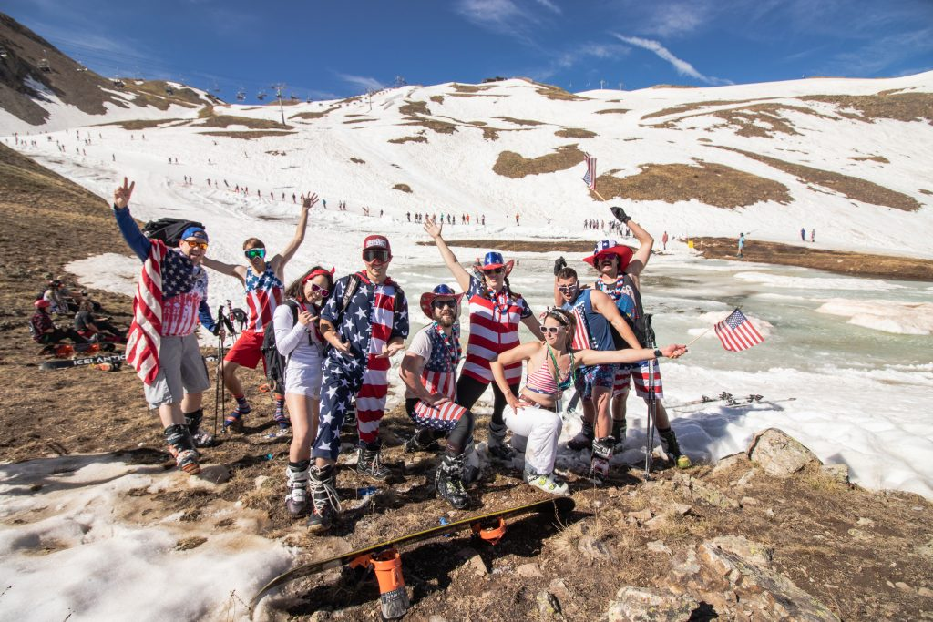 A group of friends donned in red, white and blue pose for a celebratory picture at the Lake Reveal pond skim at Arapahoe Basin Ski Area on Thursday, July 4.