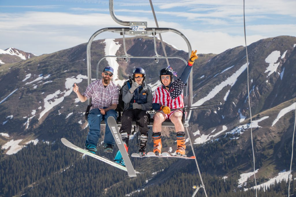 Skiers and snowboarders ride up the Lenawee lift on July 4 at Arapahoe Basin Ski Area.