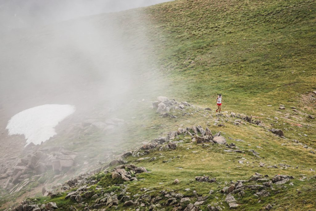 A mountain runner paces adjacent to incoming clouds in the high-alpine of Arapahoe Basin Ski Area during last August's Cirque Series mountain-running event. The race returns to A-Basin on Aug. 10.