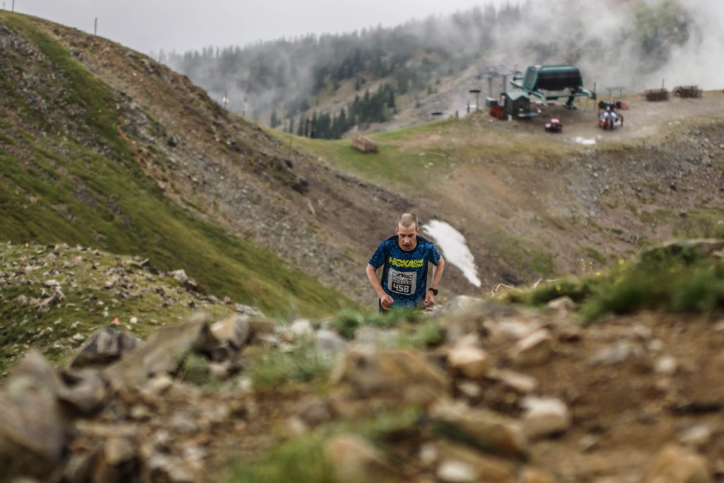 A mountain runner heads up the East Wall, the Montezuma Express chairlift in view behind him, in the high-alpine of Arapahoe Basin Ski Area during last August's Cirque Series mountain-running event. The race returns to A-Basin on Aug. 10.