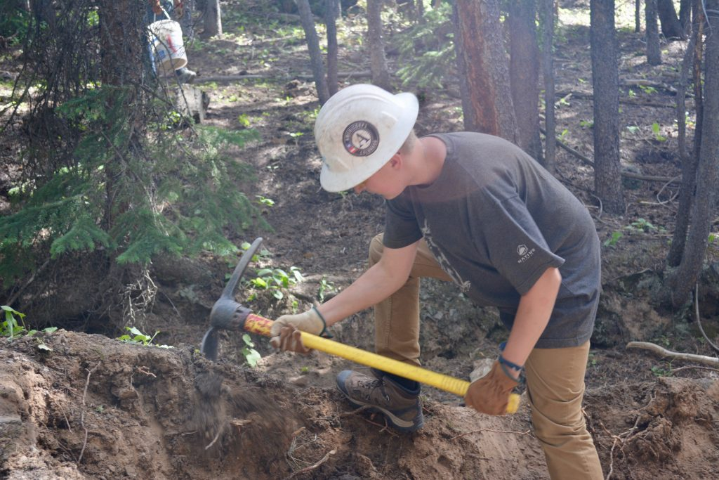 Local students work to build the Redpig Trail in Breckenridge as part of a Rocky Mountain Youth Corps program on Thursday, July 18, 2019.
