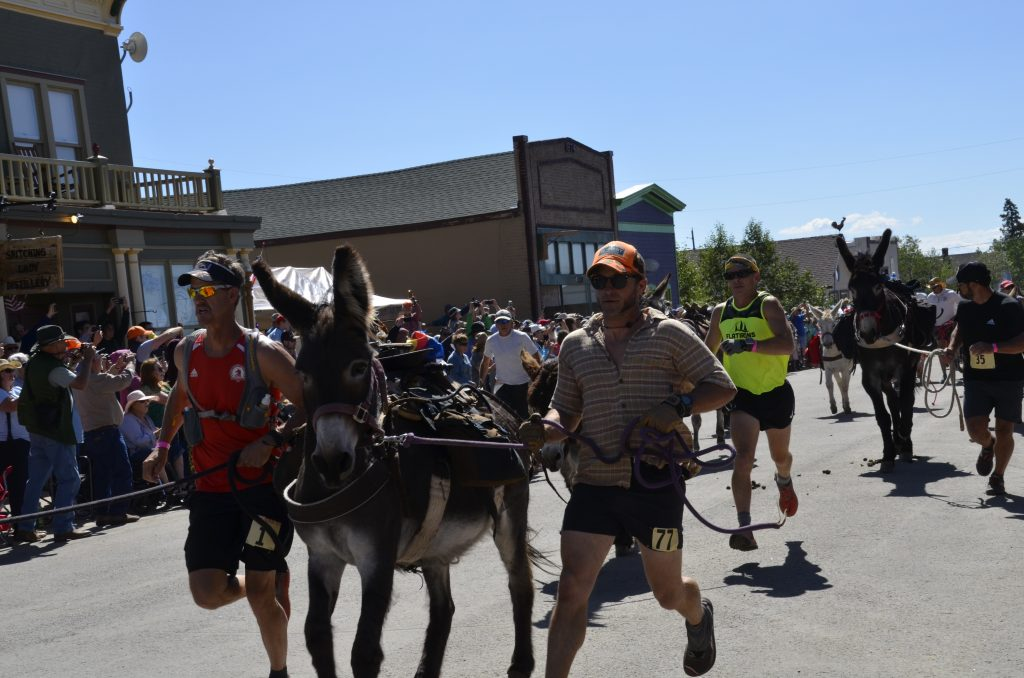 Bryan Shane, of Fairplay, runs with his burro, Margarita, on the town's Front Street during Sunday's 71st annual Fairplay Burro Days World Championship Pack Burro Race.