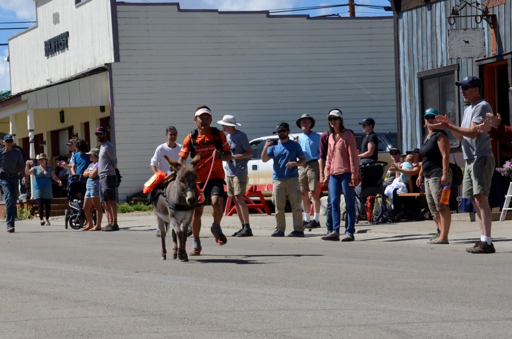 Marvin Sandoval and his miniature burro Buttercup race down Fairplay's Front Street during Sunday's 71st annual Fairplay Burro Days World Championship race, which Sandoval won in his first try. With the win, Buttercup became the first miniature donkey to win the race.