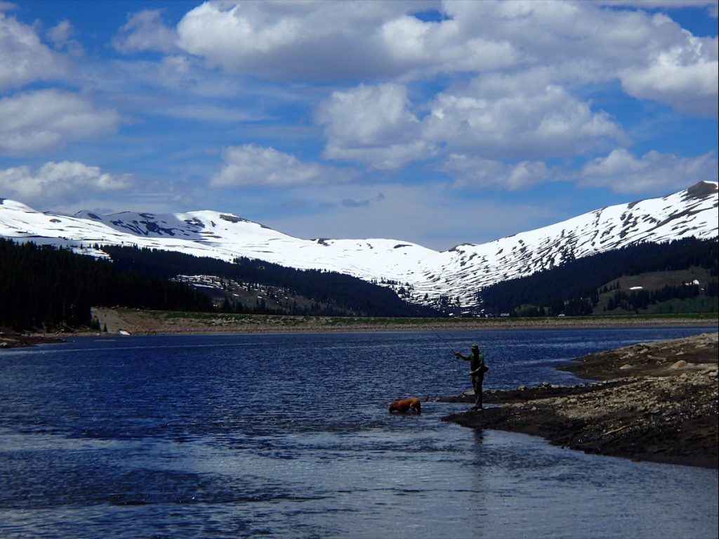 A fly fisherman casts his line out during a day on the water in Summit County.