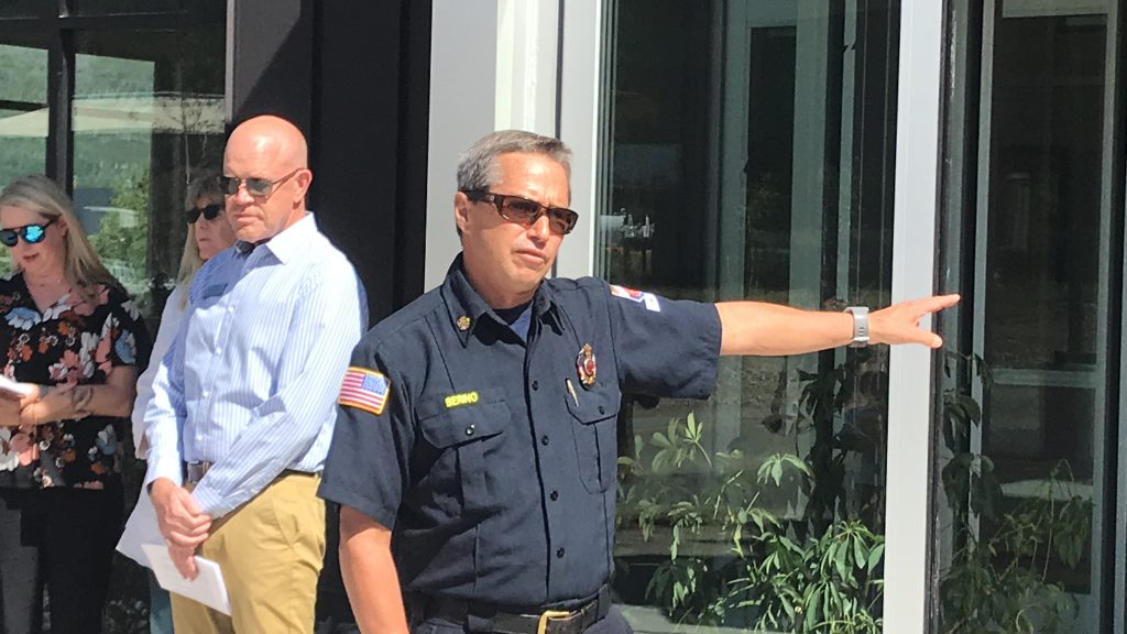 Summit Fire Chief Jeff Berino addresses the crowd outside the new administration building July 18, 2019.