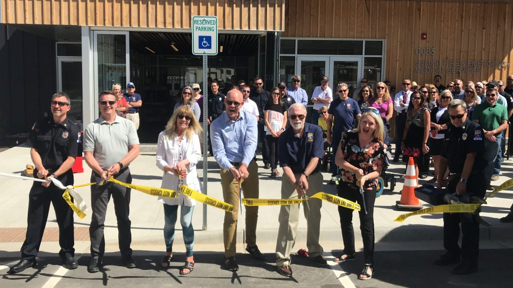 County and Summit Fire officials cut the ribbon on the new Summit Fire & EMS administration building. From left are Summit Fire deputy chief Jaime Woodworth, county manager Scott Vargo, County Commissioners Karn Stiegelmeier and Thomas Davidson, Summit Fire board president Jim Cox, County Commissioner Elisabeth Lawrence, and Summit Fire Chief Jeff Berino.