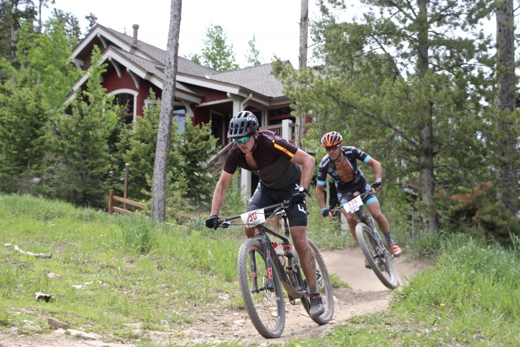 Ross Herr pedals out of a tight turn with David Gross closely behind during Thursday's Firecracker 50 mountain bike race in Breckenridge.