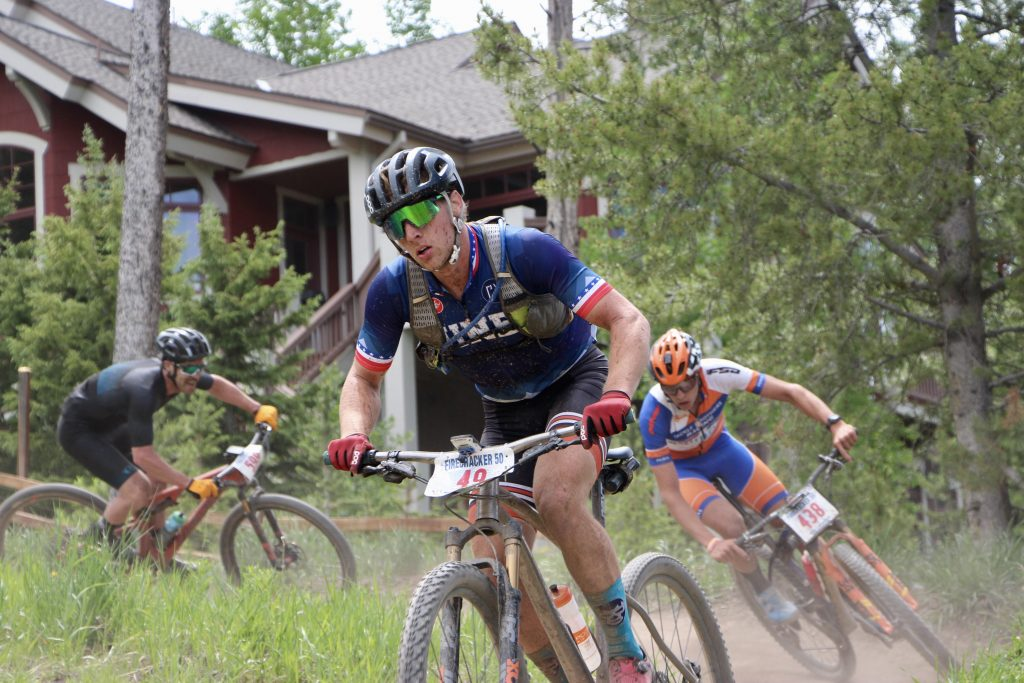 Dan McMahon rides his mountain bike with several competitors hot on his heels during Thursday's Firecracker 50 mountain bike race in Breckenridge.