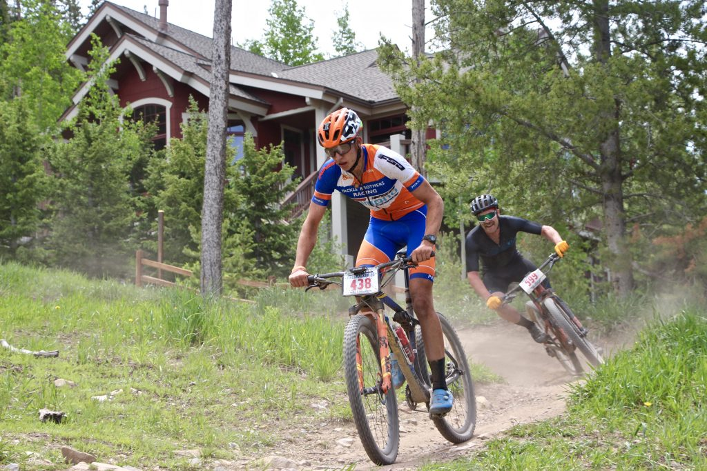 A member of the Konecny-Yackle men's duo team rides during Thursday's Firecracker 50 mountain bike race in Breckenridge.