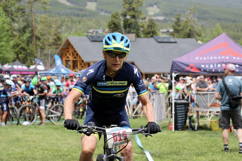 A member of the Asleson-Matheny Team 101 Duo Relay rides during Thursday's Firecracker 50 mountain bike event in Breckenridge.