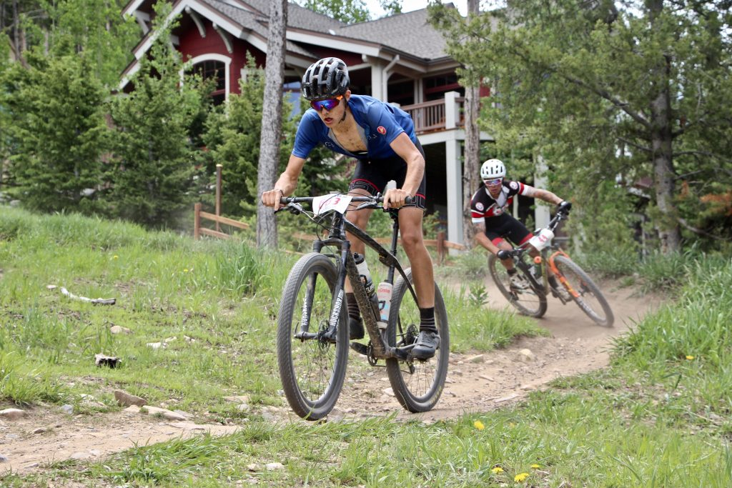 A member of the Odron-Ash men's relay duo takes a tight turn with a fellow mountain biker close in tow during Thursday's Firecracker 50 in Breckenridge.