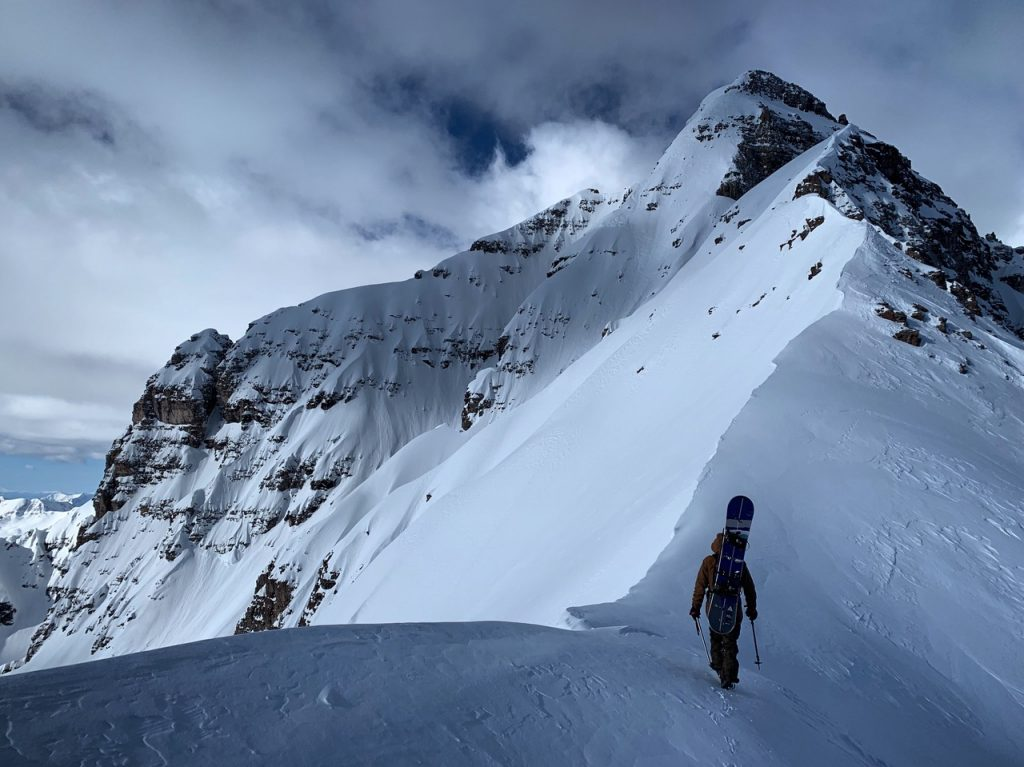 Chad Otterstrom of Breckenridge hikes along the ridge toward his line near the summit of Pyramid Peak in April, his
