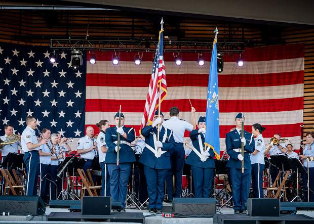 A Color Guard presents the flags during the performace of the Air Force Academy Band at Dillon Amphitheater on July 4, 2019.