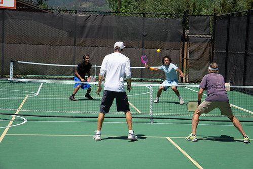 Junior Serenil (far left) and David Serenil (far right) return a volley during this past weekend's first-ever Pickle in the Peaks pickleball tournament at Rainbow Park in Silverthorne.