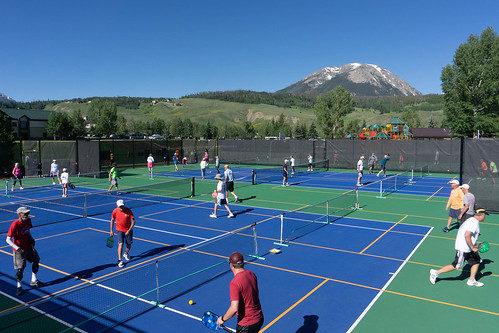 Pickleball players compete this past weekend in the first-ever Pickle in the Peaks pickleball tournament at Rainbow Park in Silverthorne, Buffalo Mountain in view in the distance.