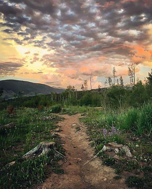 The sun sets over the trails in Summit County.