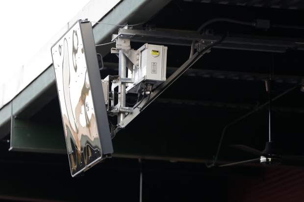 A radar device is seen on the roof behind home plate at PeoplesBank Park during the third inning of the Atlantic League All-Star minor league baseball game on Wednesday in York, Pennsylvania.