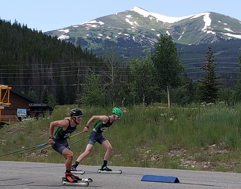 Nordic skiers are neck and neck while racing during last weekend's Summit Roller Ski Festival in Breckenridge, the snow-capped peaks of the Tenmile Range in view in the distance.